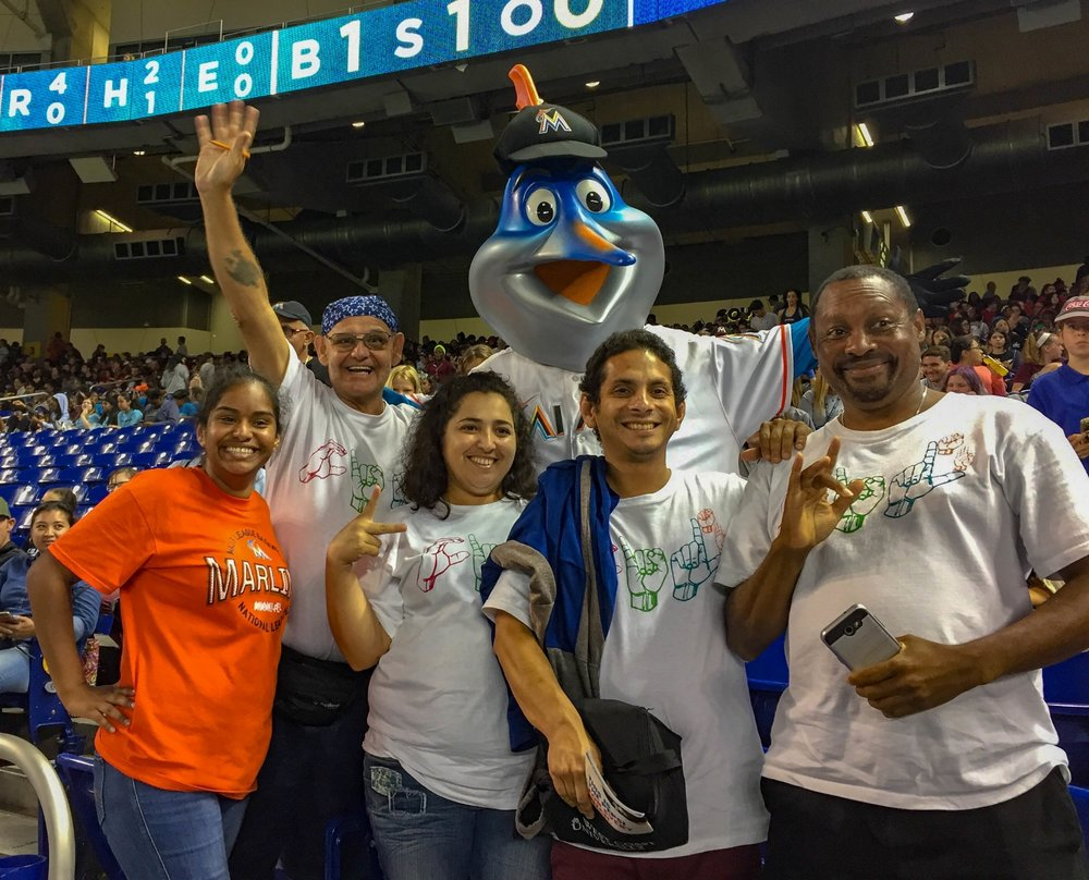 Deaf Services Students posing with Billy the Marlin at Marlins Ballpark