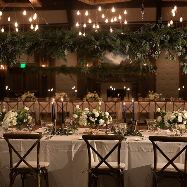 Soft pinks and white adorn this tablescape framed with hanging greens and softly lit from the glow of burning candles ❤️ Design @canvaseventdesign  Venue @stregisdv  Photo @jacquelynnphoto  Floral @urbanchateaufloral  Rentals @diamondeventandtent