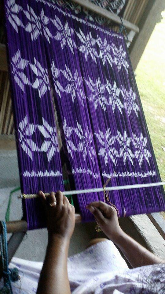 Ikat handwover using natural dye from Lontar trees to make sarong and scarf.
