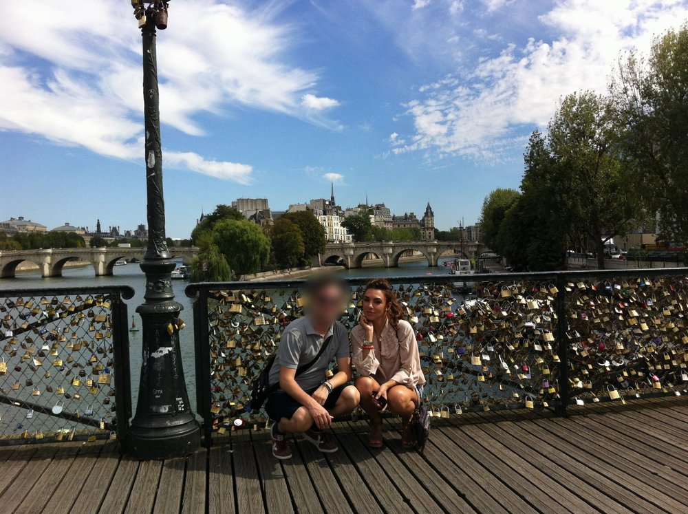 Putting our padlocks from the Pont des Arts in August 28, 2012.  However in 2015, Paris officially removed 'love locks' from the bridge due to the weight on the bridge. We were 1 love lock of an estimated 1 million.