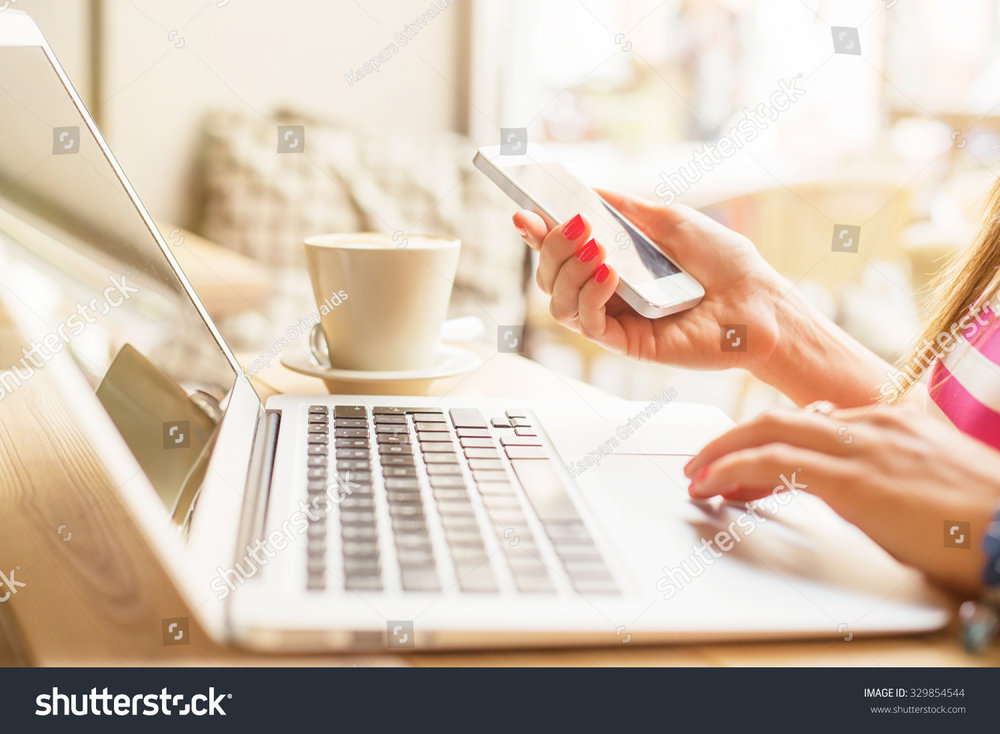 stock-photo-female-using-computer-and-cellphone-329854544.jpg