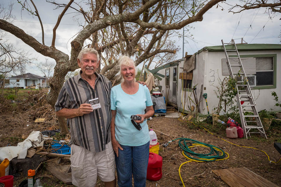 This is Leslie and Elaine. They had lived in their mobile home seen behind them for 20 years. The roof and walls are smashed, widows broken and all of their worldly possessions are soaked with rain water. Thank you to everyone that helped put a light in this families hands.