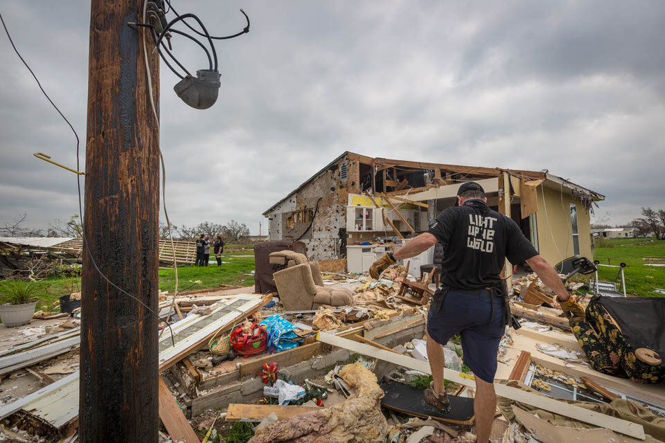 Board member Tim Campbell begins surveying the devastation of one of the many homes we visited.
