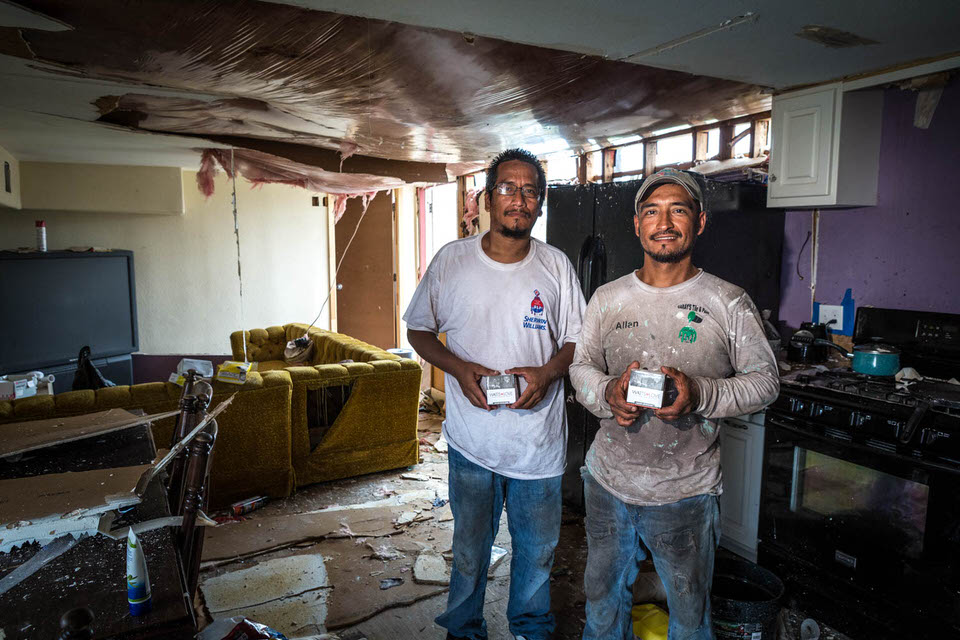 "This is Allan (right) and his brother Hector (left). They are standing in what remains of Allan's trailer home. It is devastated and beyond repair. We were a tad concerned as we entered into what remained of his trailer. ""I've lost everything and my home is gone. All gone."""