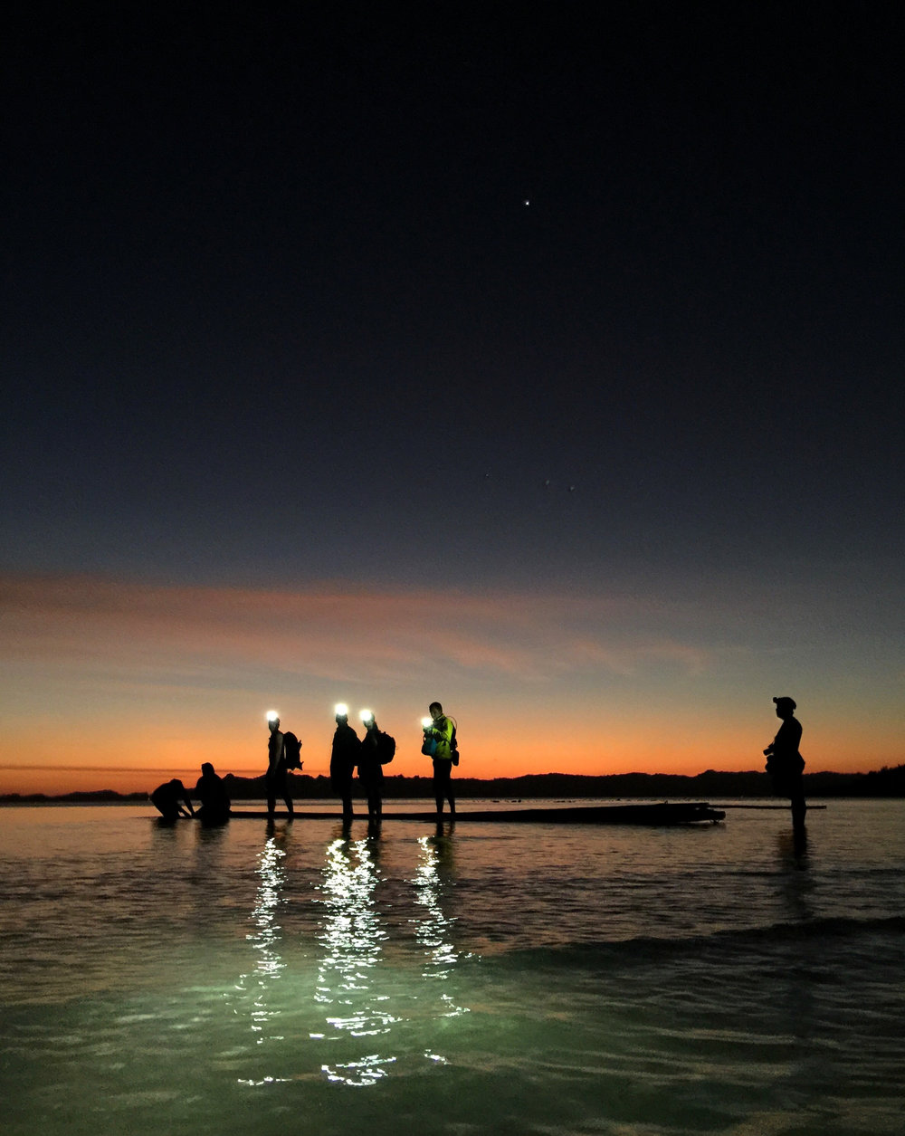 "Team members witness inimitable beauty as they ride a raft from shore to banka boat for the ""commute"" home at night."