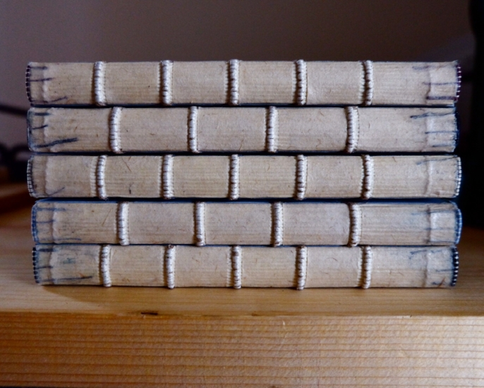 Five commonplace books with freshly lined spines. The raised sewing visible between the linings will eventually become the iconic raised bands that give well-bound books their distinctive aesthetic.