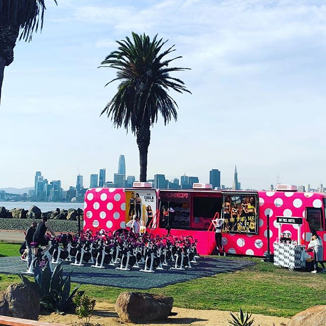 Who said you can't have a #spinclass #outdoors #outside with the #sfskyline? Leave it to @victoriassecret #pink #vspink to rent the lawn from @merseasf and bring a VERY #pinkbus #polkadots to boot?! #bravo !! #merseasf #spinning #treasureisland #sf #sanfrancisco