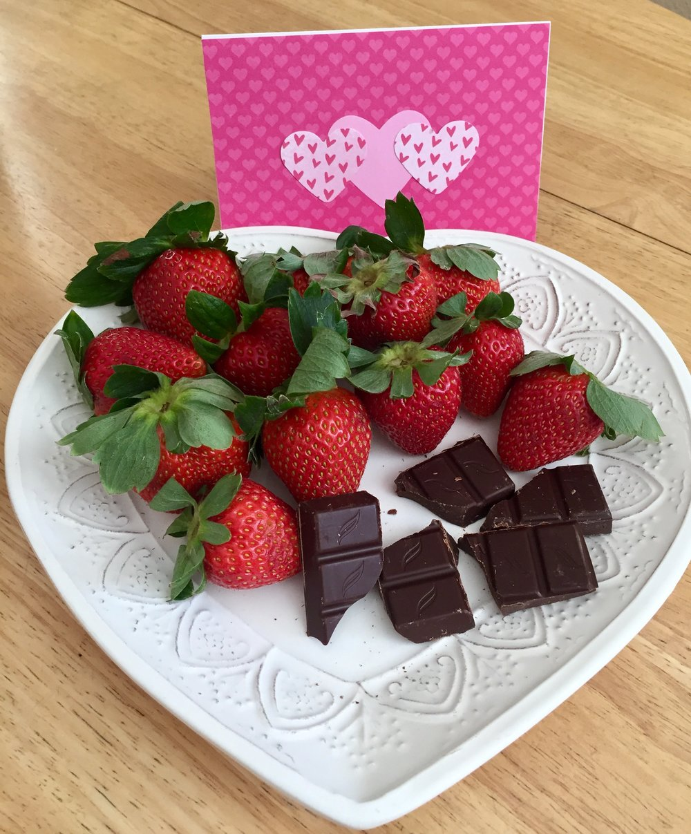 For a sweet treat, enjoy berries with some dark chocolate!
