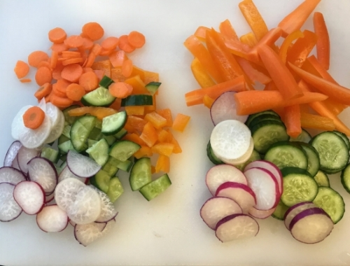 Carrot, Orange Bell Pepper, Radishes and Persian Cucumbers.