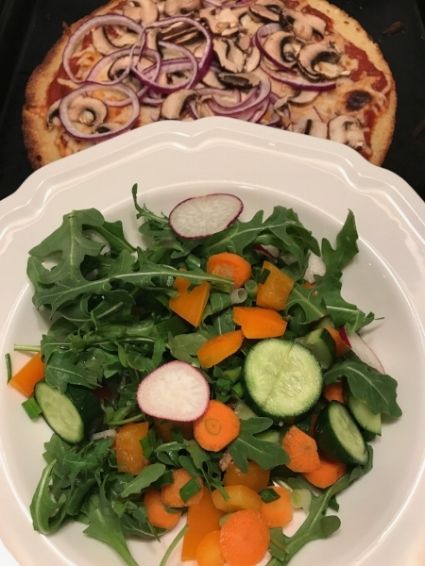 My arugula salad the next night with mushroom, red onion pizza on Trader Joes Cauliflower crust. YUM!