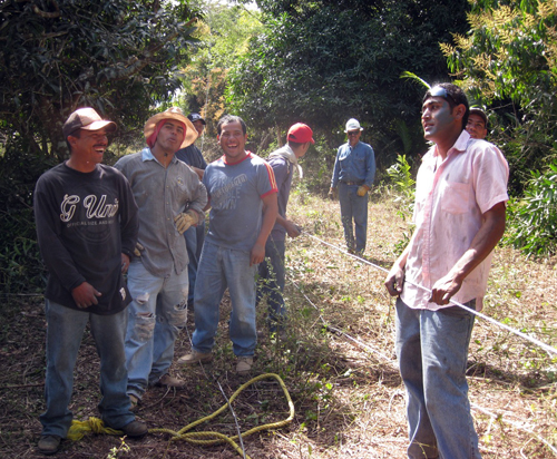 CFE Local Contractors Laying Aluminum Cable Through the Jungle. (One of them did not want to be in the photo…Could he be one of the copper thieves?)