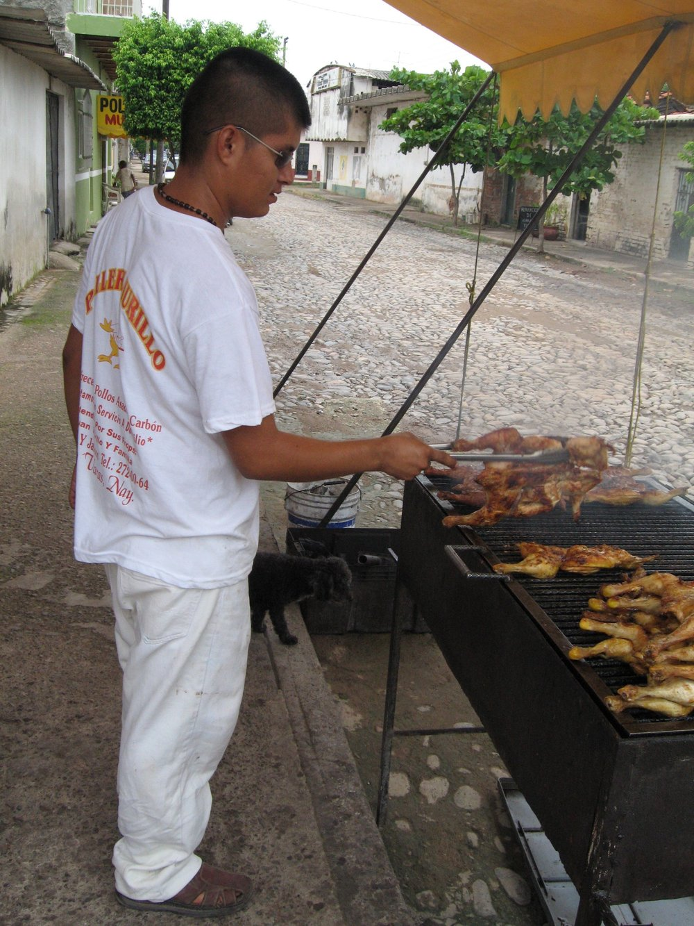 one of many grilled chicken stands in the surrounding towns.