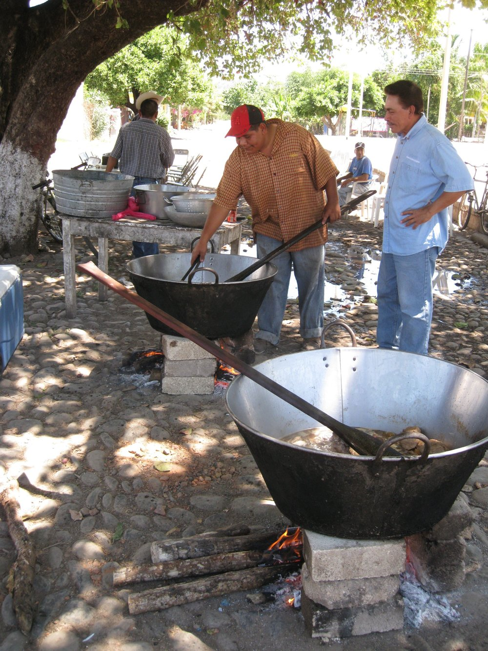 preparing chicarrones (pork cracklings) in the nearby town of otates.