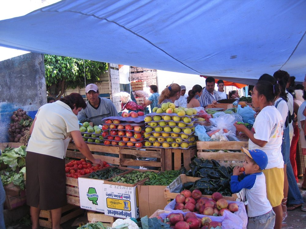 fruit and vegetable stand at the weekly open-air market in nearby zacualpan.