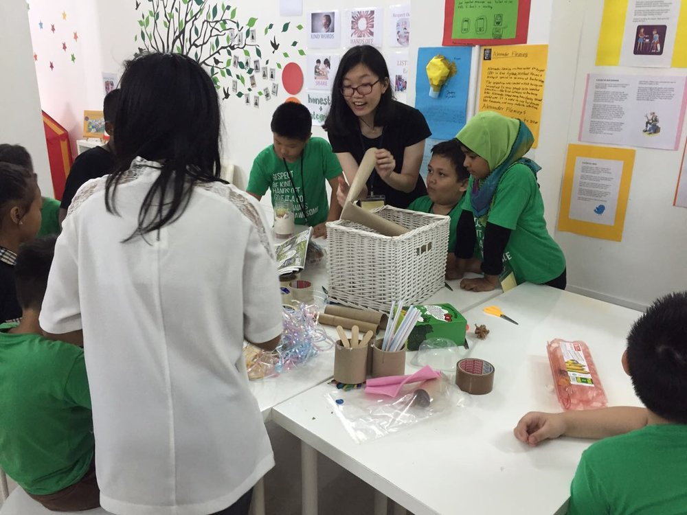 Teacher/Scientist, Yi Han, guides students through the challenge.