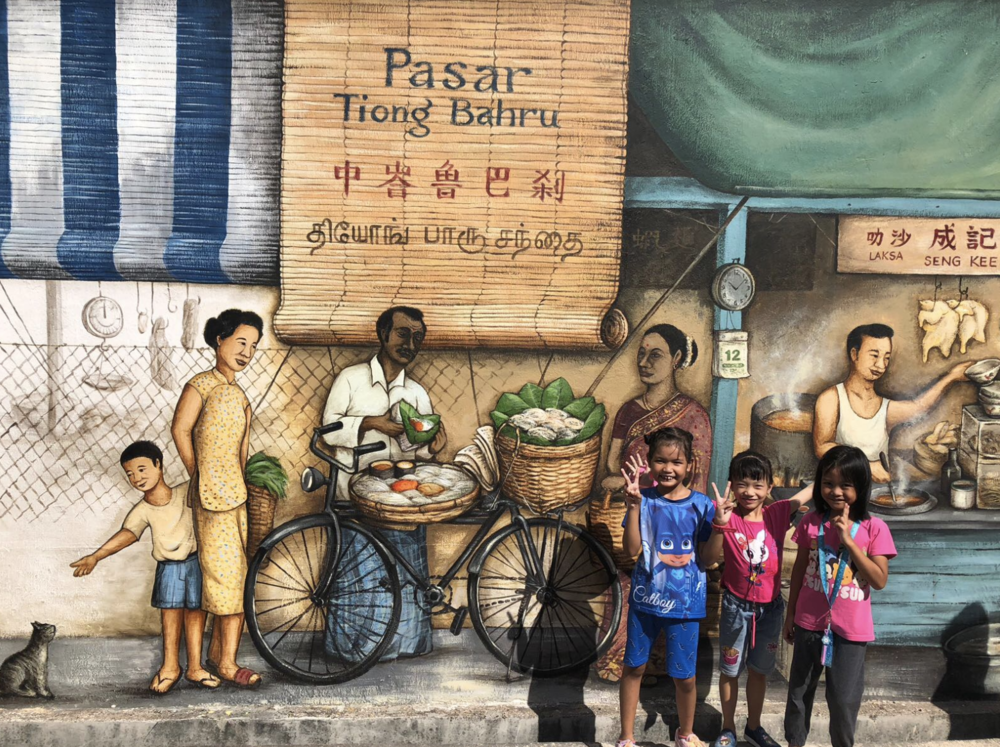Kids enjoying the Tiong Bahru Art Murals.png