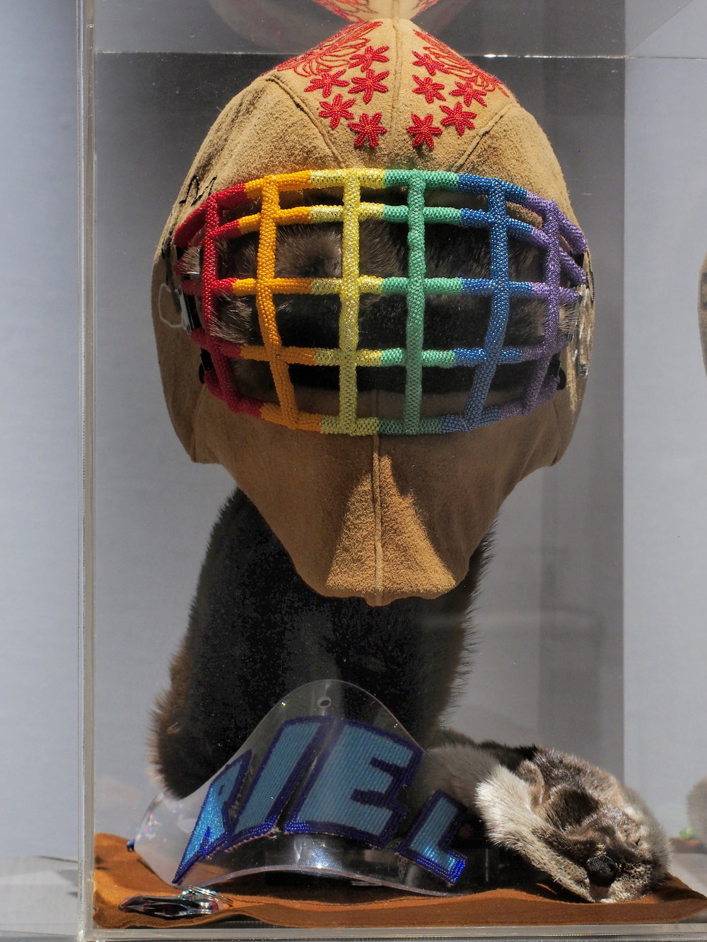 Judy Anderson,  This one brings me the most pride,  2016, beads, moose hide, goalie helmet, plexi, otter pelt.