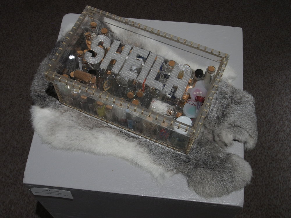 "Judy Anderson, S he is Worth Celebrating,  beads, plexi, various items,  sinew, rabbit fur, 12""L x 7 3/8"" w x 5"" H, 2016"