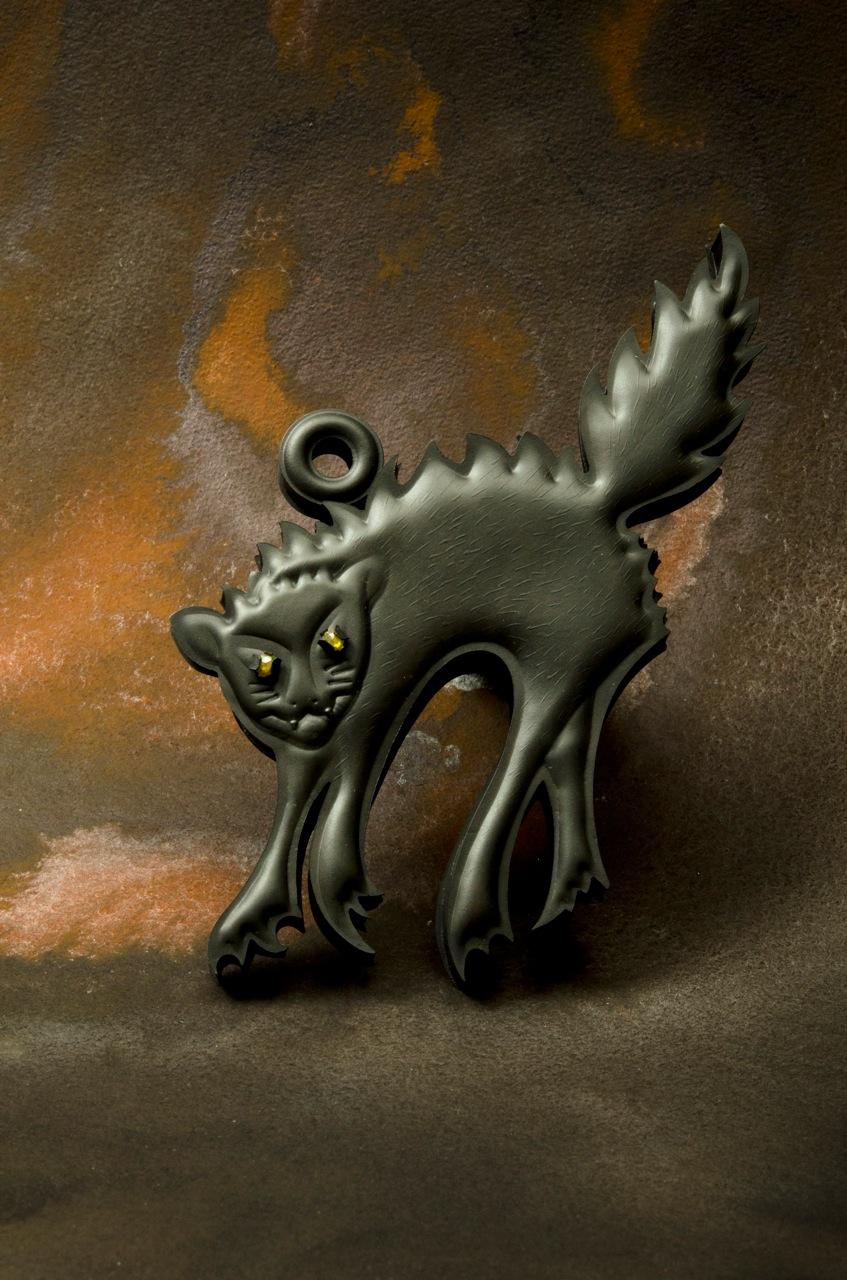 Helen Britton,  Cat (pendant) , 2016, silver, stones, photograph courtesy of the artist