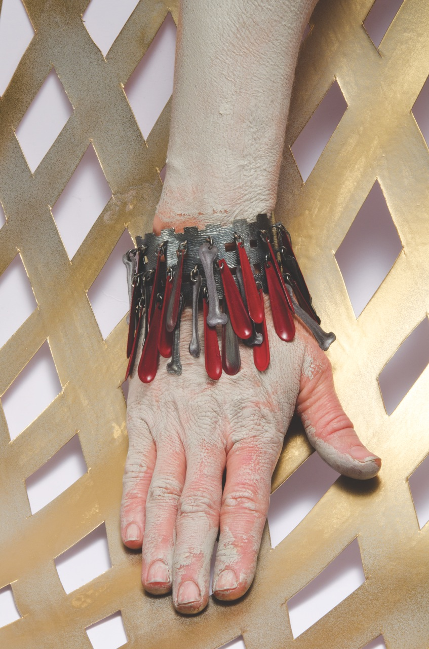 Helen Britton,  Dropbones  ( bracelet ) 2014, silver, paint, photograph courtesy of the artist