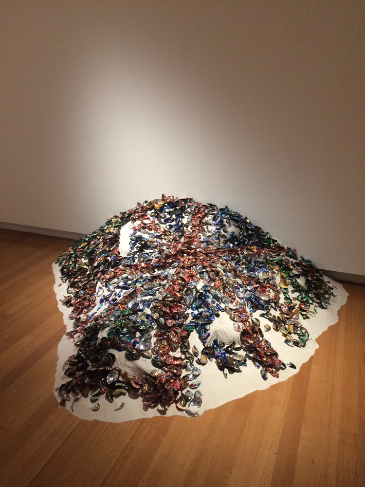 Megan Cope,  RE FORMATION Part 2 , 2016, beer cans formed into the shape of middens and silica sand from Minjerribah, installation view, QUT Art Museum. Courtesy of the artist and THIS IS NO FANTASY + dianne tanzer gallery