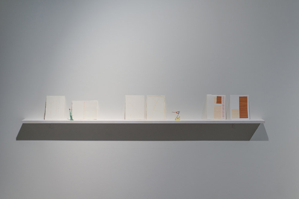 """Josephine Hellen Franklyn,  Notes and Reflections,  2017, Three Installed shelves, mixed media on paper, assembled objects (various materials), iPad, timber box, 10"""" video, looped."""