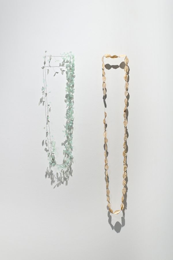 Cara Johnson,  Tether,  2017, plastic from a found tree guard, mild steel 1760mm circumference  Cara Johnson , Messmate (Eucalyptus obliqua),  2017, paper, paper thread, natural dye 2520mm circumference