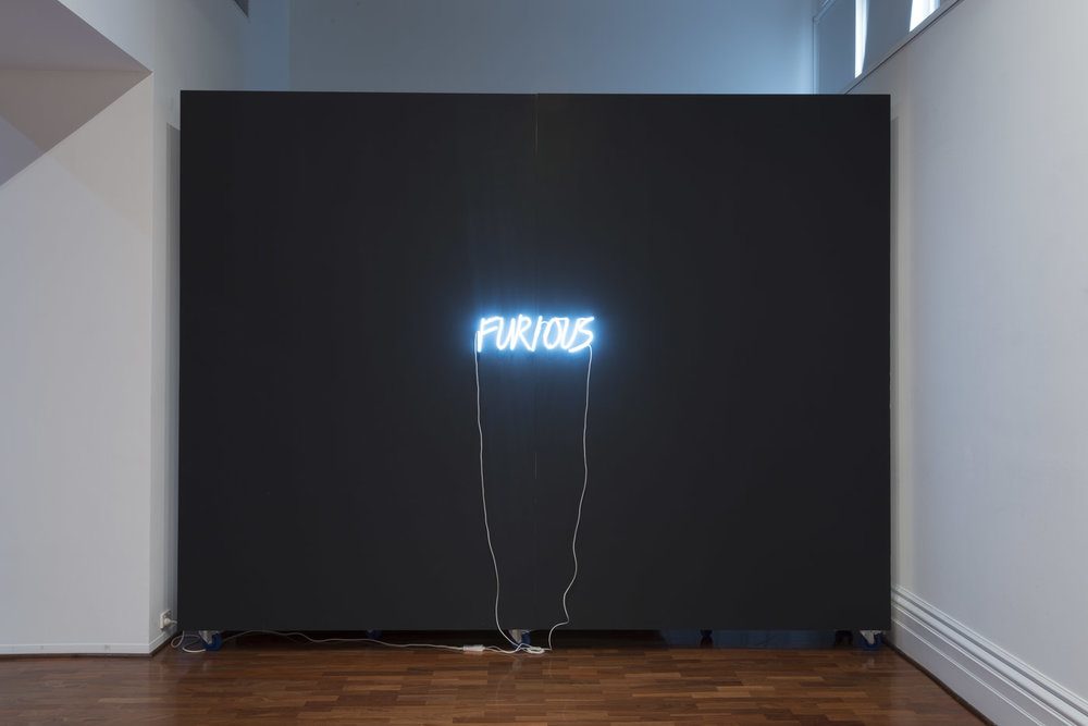 Kate Just,  FURIOUS , 2015, neon text, black paint, 15 x 80 x 5 cm