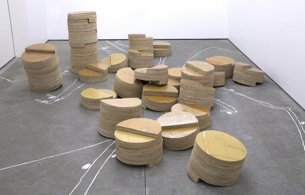 Isabel Nuño de Buen, Untitled (three pillar system),  2017, Cardboard, glue, varnish, chalk drawing on the floor, three pillars 35x200cm each, Installation dimensions variable