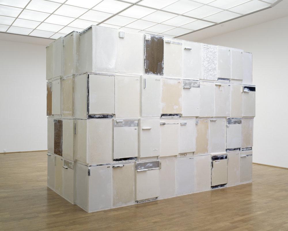 Thomas Rentmeister,  Santo *, 2003, Refrigerators, Penaten baby cream, 340 x 530 x 240 cm, Exhibition view Museum fur Moderne Kunst Frankfurt am Main, 2004. Photo: Axel Schneider