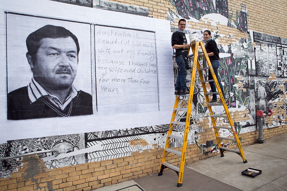 "Paste-up at FCAC - For the first time, MAPgroup has made a paste-up.It showcases photos from our ""Beyond Borders"" project by Tobias Titz and is at Footscray Community Arts Centre until 28 June. Why not stop by to check it out and while you're at it, grab a cuppa in the cafe and check out the exhibitions?Thanks to FCAC for all their help.http://footscrayarts.com/event/beyond_borders/Photos of paste-up at Footscray Community Arts Centre, for MAPgroup's ""Beyond Borders"" project. Paste up photographs by Tobias Titz. Photography by Krystal Seigerman, 2015."
