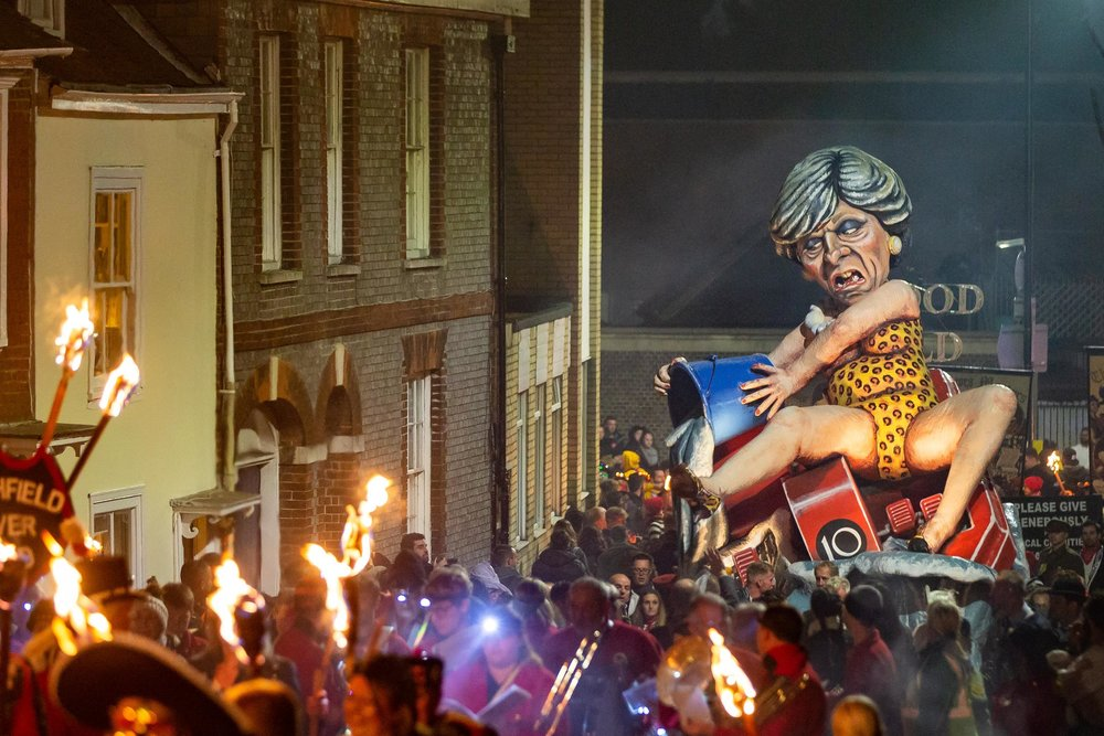 An effigy of Theresa May is paraded through the town of Lewes, East Sussex, England, during the annual bonfire night procession which was held by the Lewes Bonfire Societies on November 5, 2018. The parade commemorates Guy Fawkes, who died in 1605 following an unsuccessful attempt to blow up The Houses of Parliament. Lewes, East Sussex, England - November 5 2018.