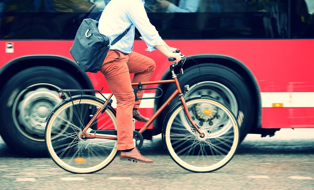 eusp-man-riding-bike-street-bus-mobility.jpg