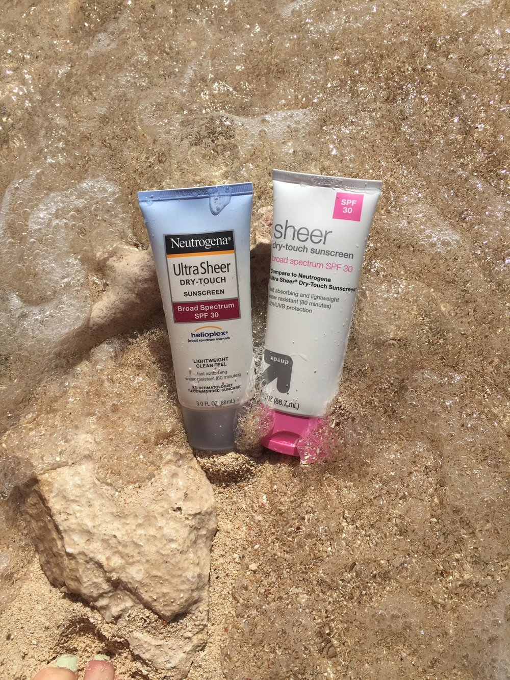 Tested the Up & Up Sheer Dry Touch Sunscreen and compared it to Neutrogena Ultra Sheer Sunscreen. A few minor ingredient differences, but we give this store brand copycat a thumbs up.