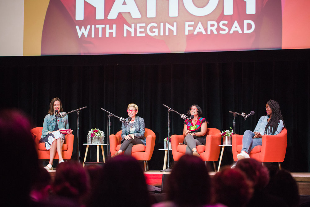 Panel of four podcasters on stage