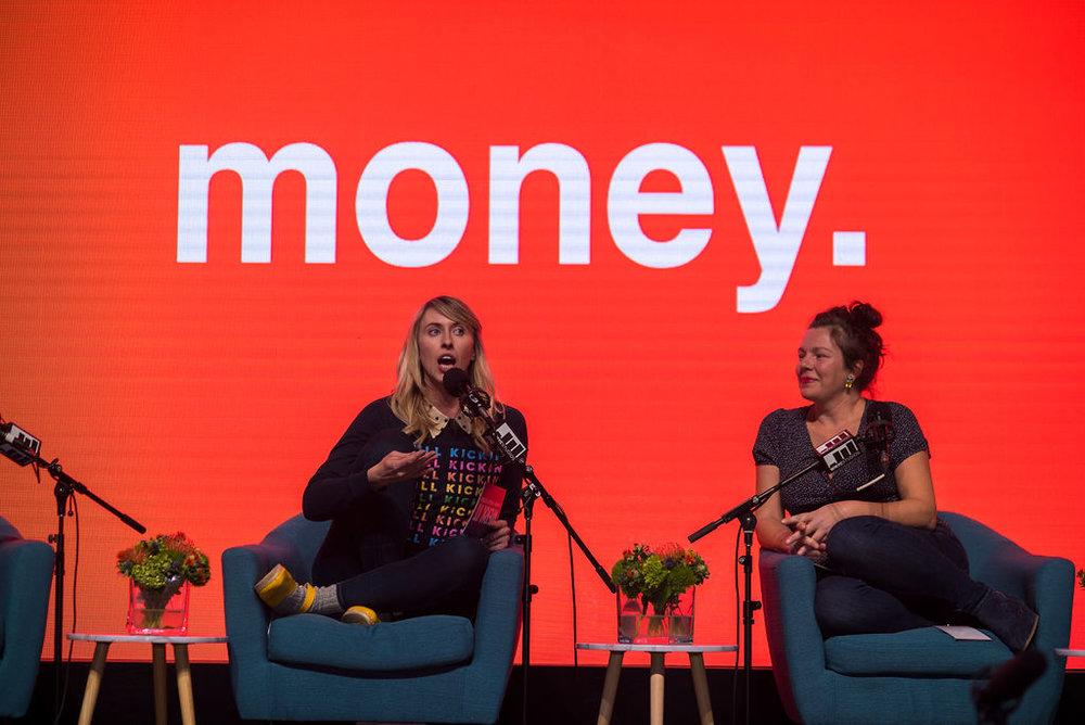 Nora McInerny and Ami Spishock on stage seated behind microphones