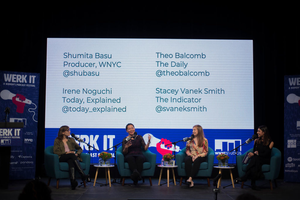 Four panelists presenting on the main stage