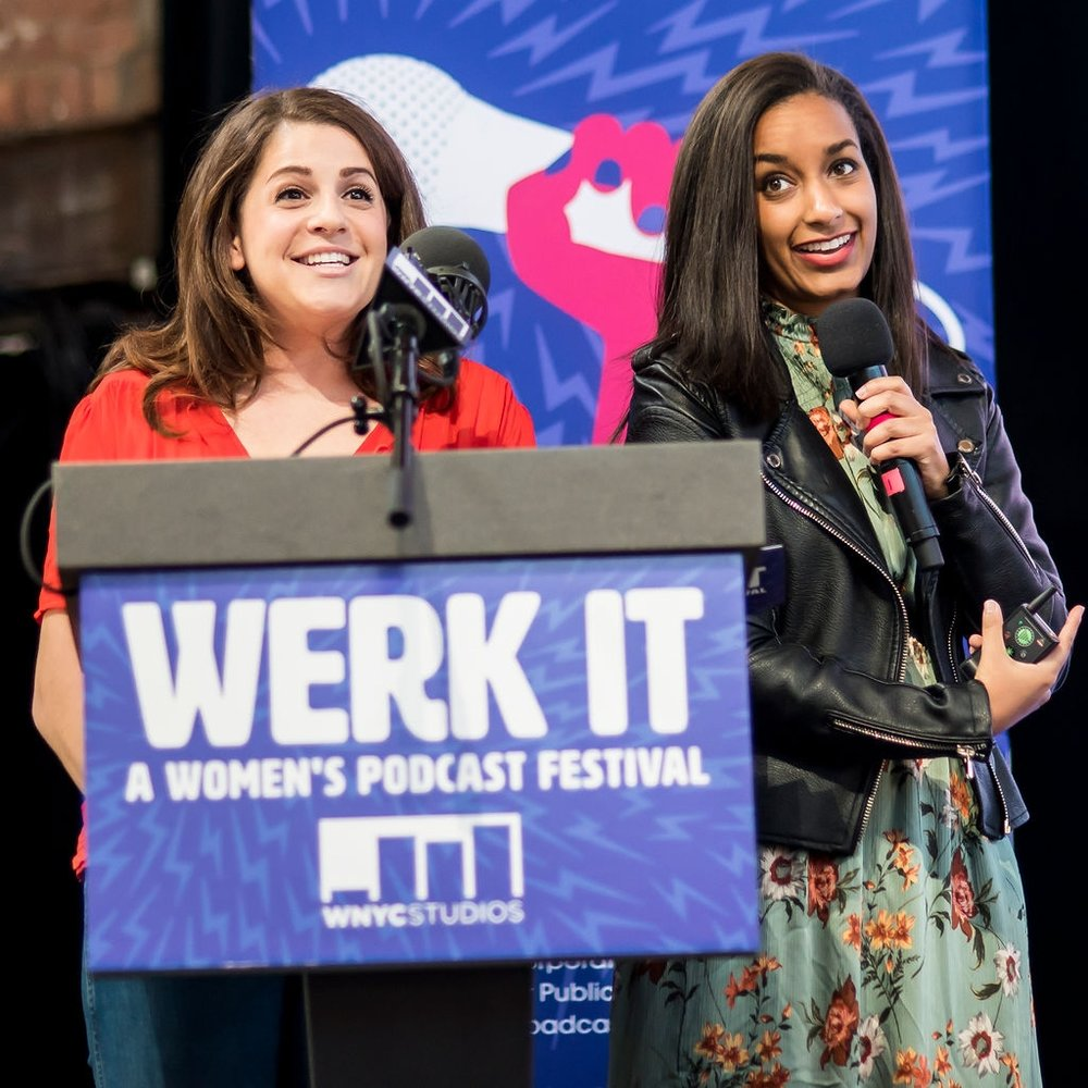 Becca Bressler and Bethel Habte presenting on stage behind a podium