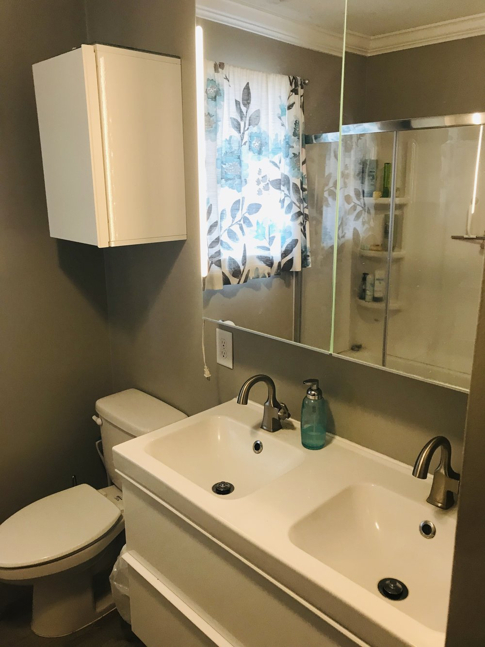 We were able to find a smaller double vanity that fit this space so that two kids could brush teeth/wash up at the same time.