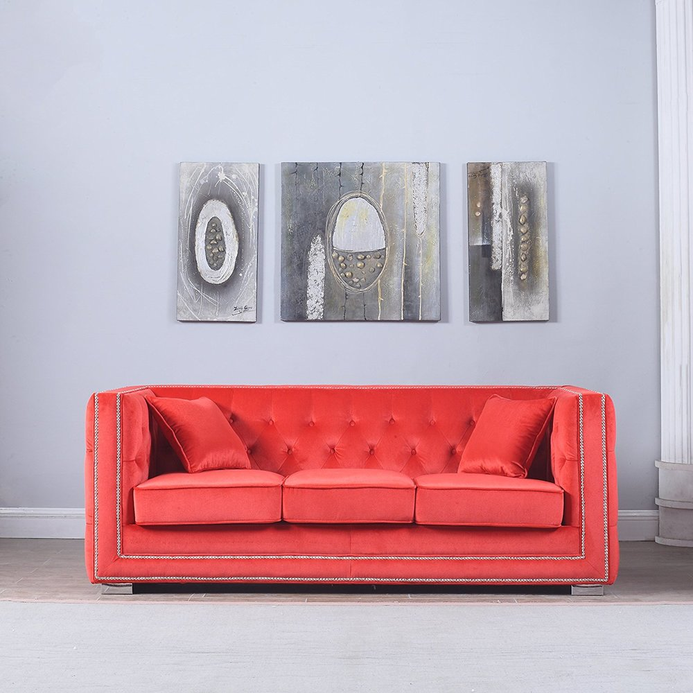 Deep-Seated Red Couch - While Marilyn's style was almost overwhelmingly simple when it came to interior design, she clearly loved pops of color. A red couch similiar to the one pictured sat in the living room of her Brentwood home.
