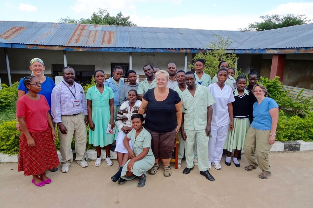 Rebecca, Debbie, and Dr. Gerlach with Mvimwa Holy Spirit Abby's Medical Staff.