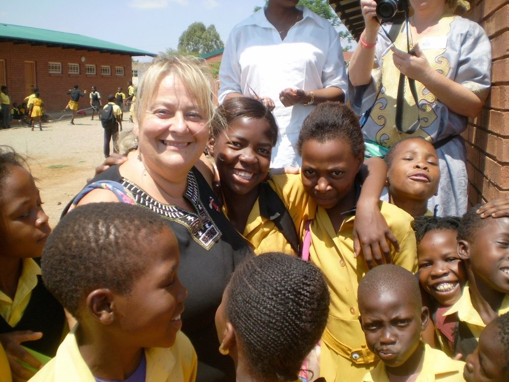 Debbie with Sjambok School students.