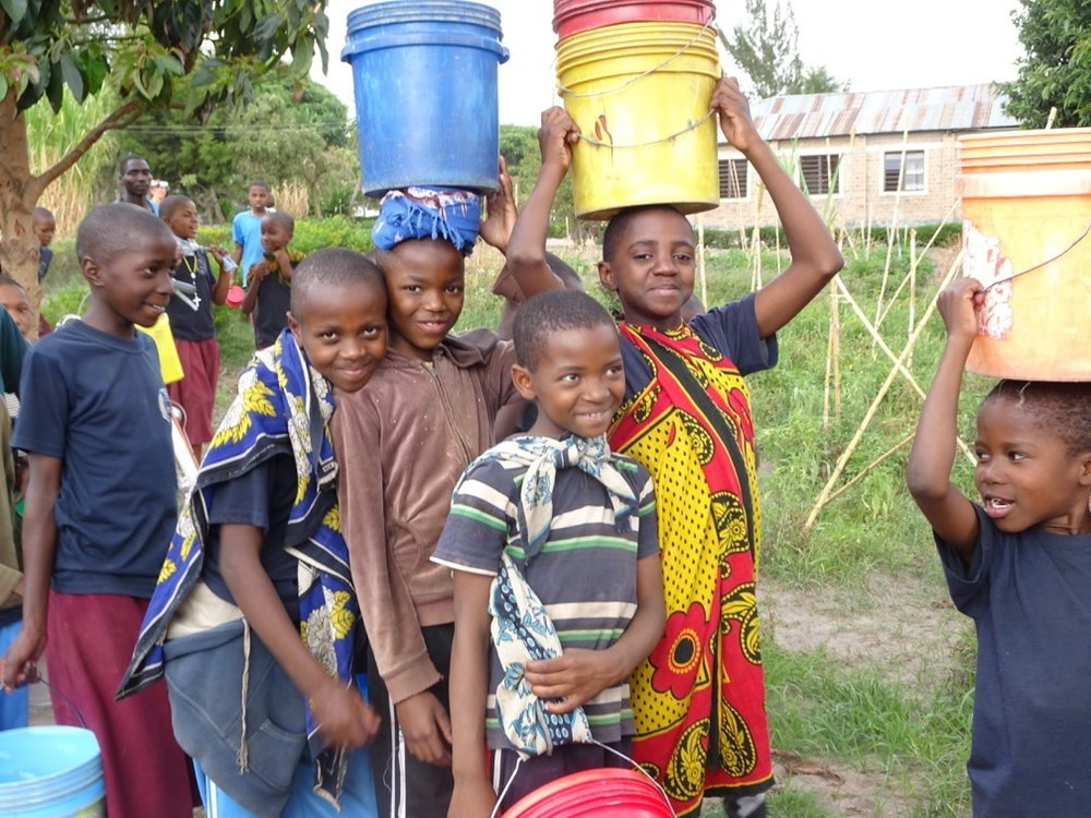 Children in Tanzania's Ntemba Village begin their several kilometer trek to get water for their families.