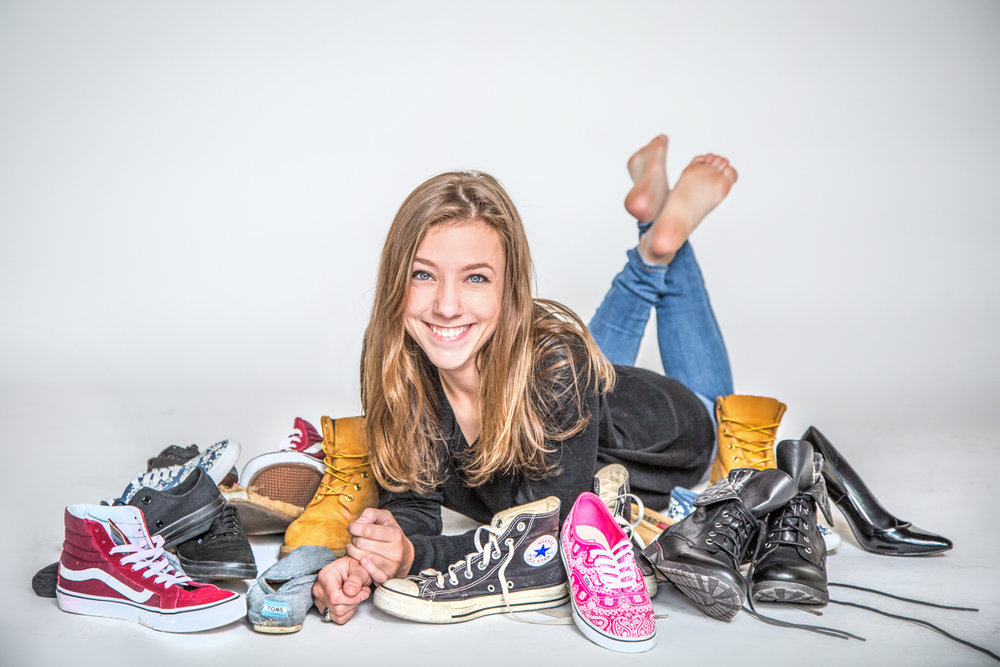 Portrait-HIgh-School-Seniors-girl-smiling-and-happy-surrounded-by-shoes-194.jpg