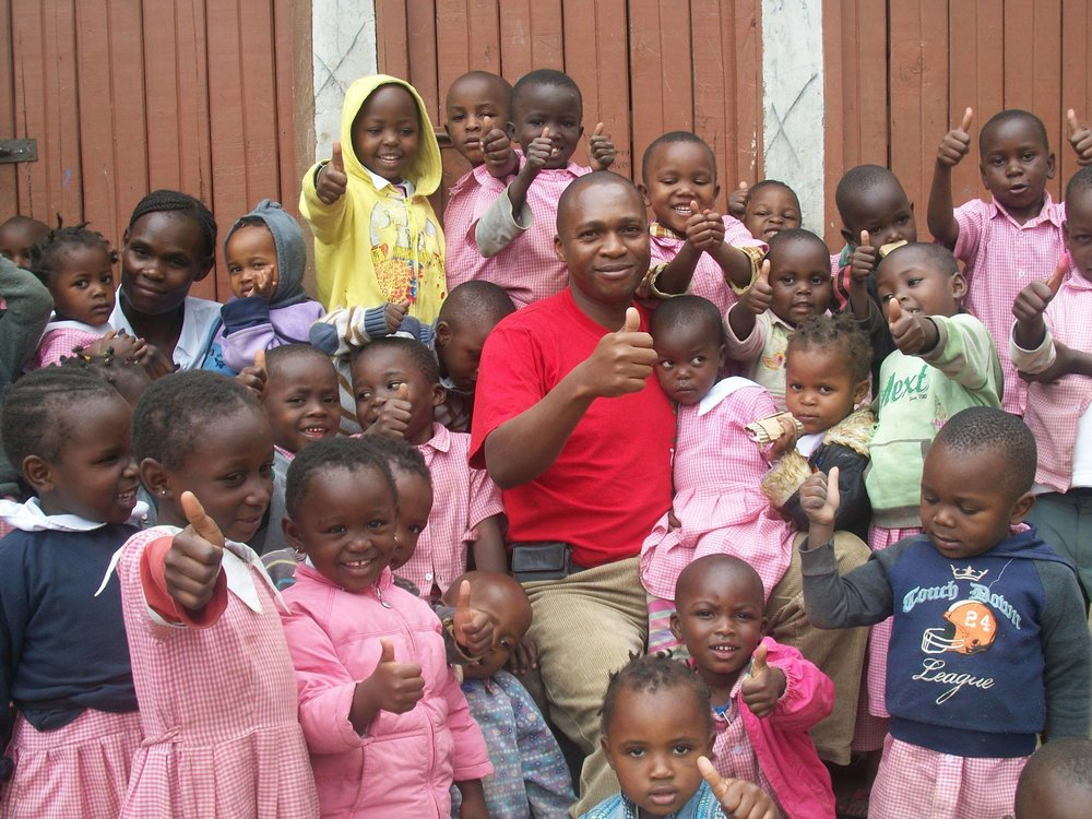 Mathare Rafael and kids.jpg