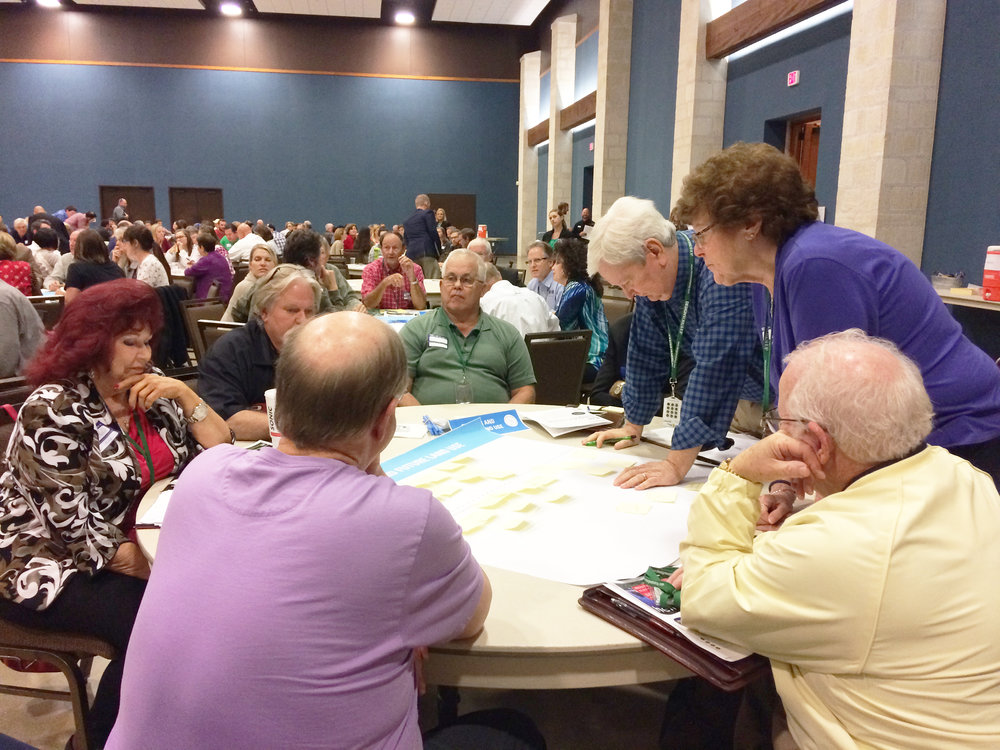 Through a strengths and opportunities sticky note activity, community members brainstormed ideas for the future of New Braunfels.