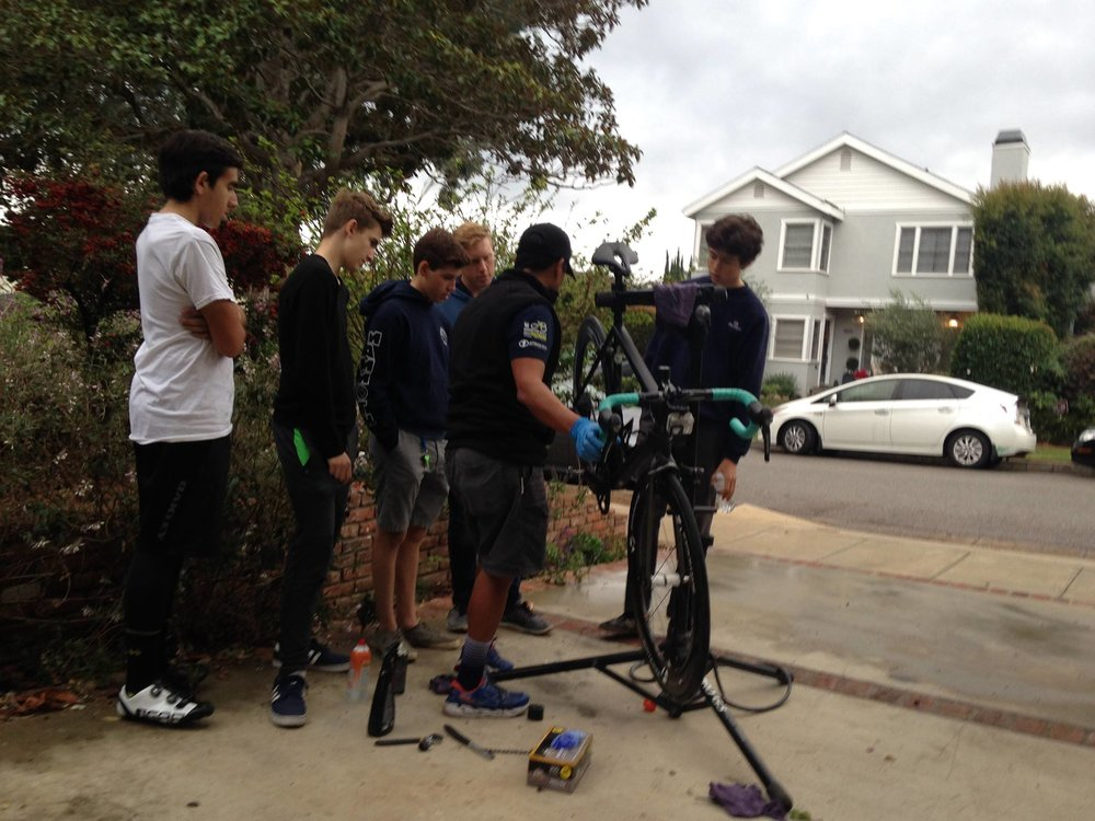 Helen's Cycles head mechanic Erick Rodas donates his time to put on a bike maintenance clinic for our La Grange Development juniors team.