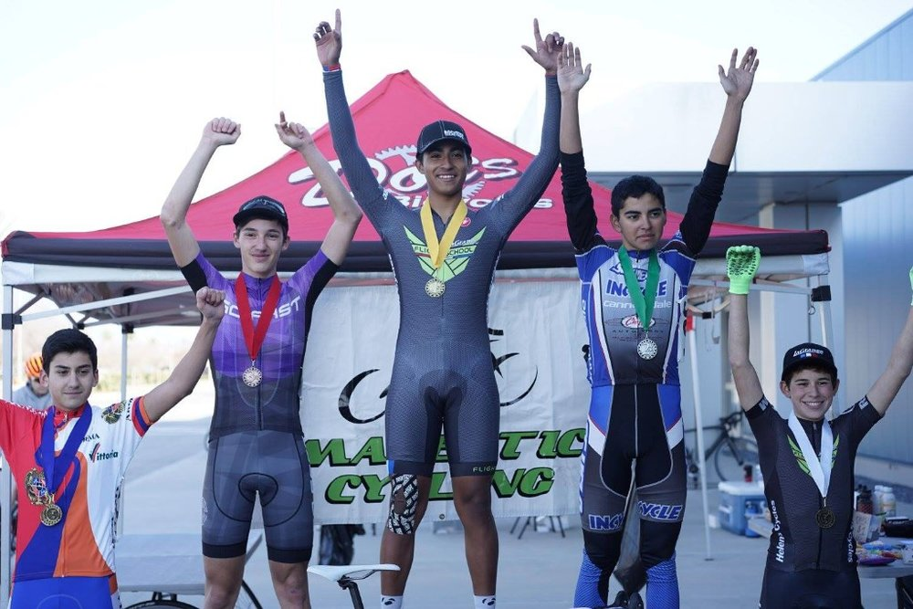 Esdras Roldan with the team's first win of the season and Ari Elkins on the podium at the Majestic Cycling Criterium.