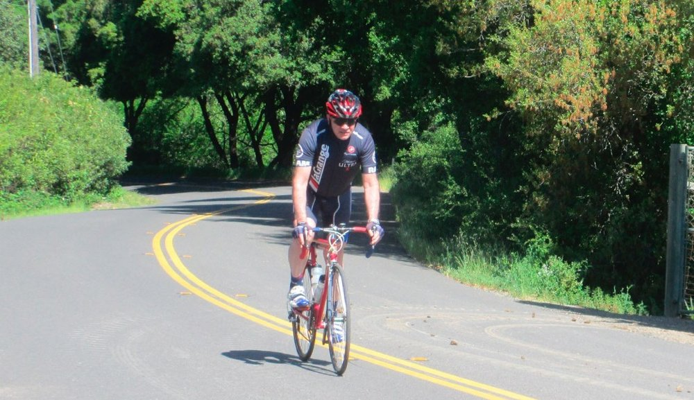 "Doug Herrick: ""Representing on West Dry Creek, Healdsburg, Sonoma County (Wine Country!). This is a regular route for me, to Westside Road and Wohler Bridge, then Eastside Road back home in Windsor. I do bump into Trudi and Peter on occasion, but I'm the only one out here in a La Grange kit (I do meet the occasional ex-So Cal racer and even a couple long ago La Grangers out here--you know they know the club because they don't say Lah Graynge!)  If you come up for Levi's Fondo or just to visit and have your bike with you, feel free to contact me--I know all the good routes."" :-)"