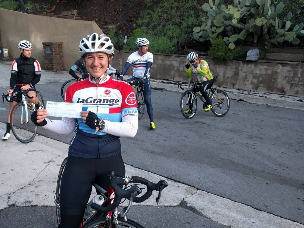 Katie Rollins  got the first La Grange win of the season, when she took the win in the Cat 4 Santa Barbara County Road Race! Here she is at the top of Mandeville Canyon with her winners check.